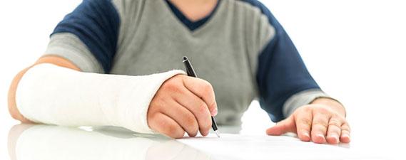 Photo: Man signing insurance claim form